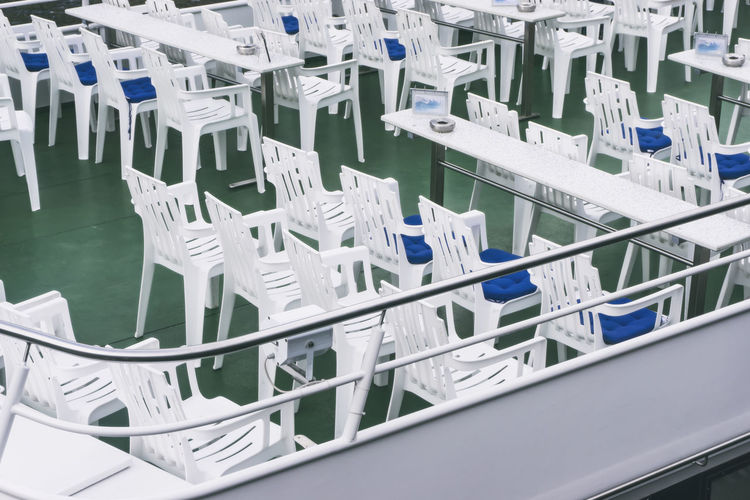 White plastic furniture on sightseeing deck of river cruise boat on Spree River Berlin Germany 🇩🇪 Deutschland Spree River Berlin White Furniture Chairs Color Image Furniture No People Outdoors Plastic Chairs River Cruise Boat Sightseeing Deck Table White