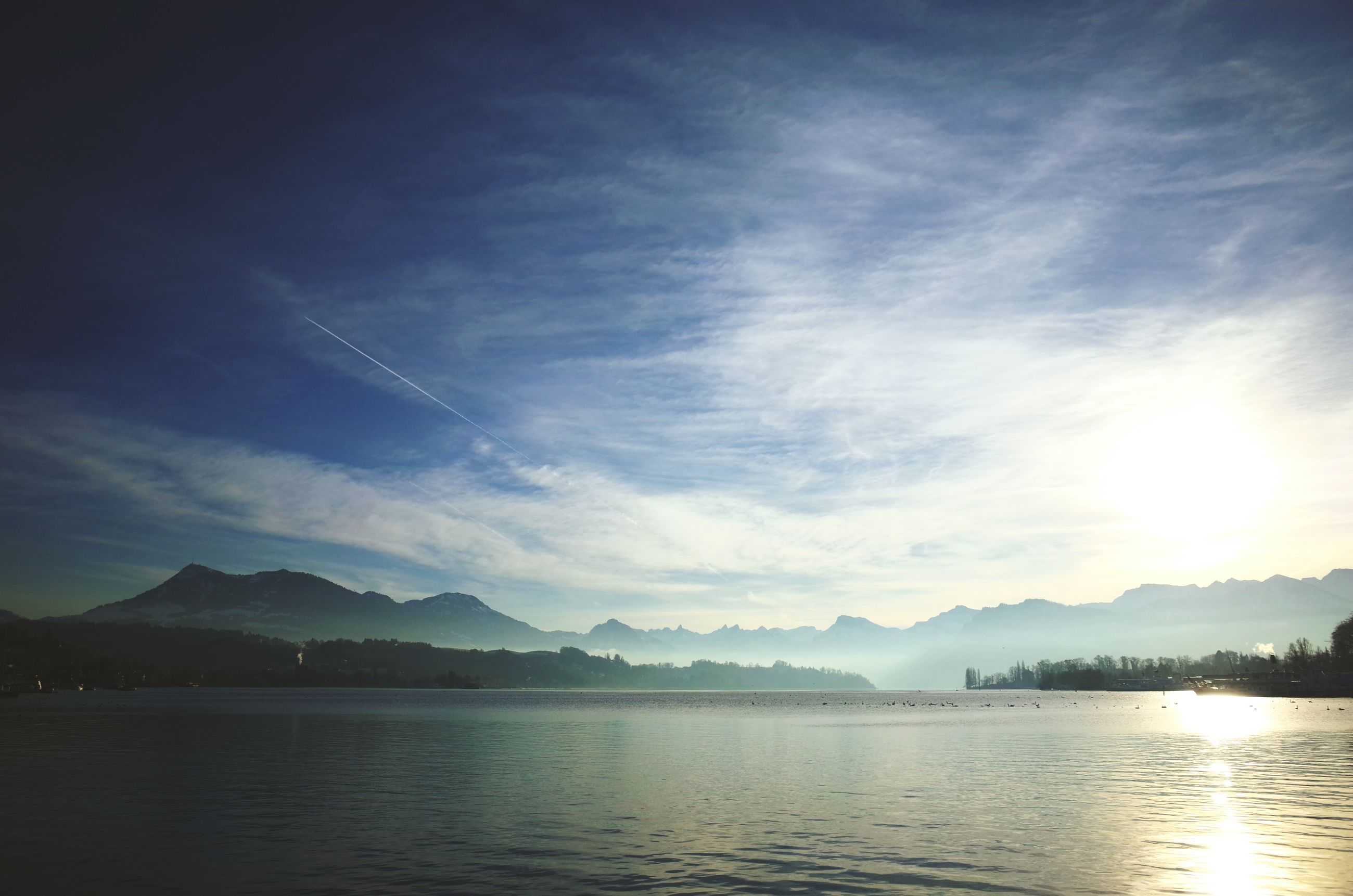mountain, water, tranquil scene, mountain range, scenics, tranquility, sky, beauty in nature, lake, waterfront, cloud - sky, nature, reflection, idyllic, cloud, river, sea, non-urban scene, sunset, outdoors