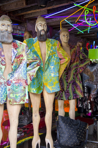 Men's mannequins in bright multicolored jackets, without trousers, in heels in a shop window in Venice Heels Man Mannequin Mannequins Shopping Counter Gay Homosexuals Jacket Multi Colored Neon Lights Purchase Purchases Retail  Shop Shop Window Shopping Time Showcase Trade Venice Fashion Stories