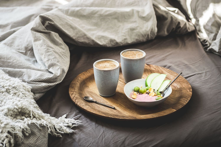 Healthy winter romantic breakfast in bed. Coffee, natural berry yogurt with cereals, grapes and green apples on the rustic wooden board. Clean eating, eco diet, vegetarian food concept. Breakfast Couple Diet Espresso Romantic Vegetarian Food Winter Bed Blankets Coffee Coffee - Drink Cup Food Food And Drink Freshness Healthy Eating Hot Drink Mug No People Romantic❤ Still Life Textile Vegetarian Food Concept Vegetarian Food Style Yoghurt