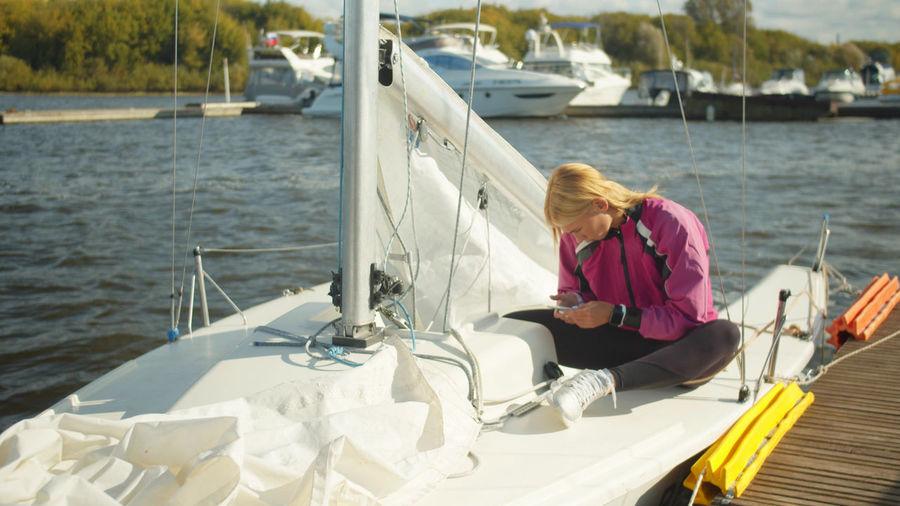 Woman sitting on boat in sea