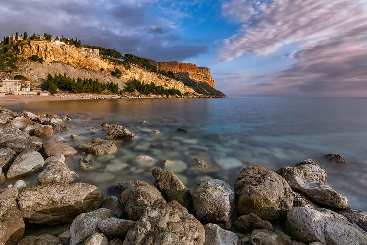 Sunset on the rocks. Cassis, south of France Beach Beauty In Nature Blue Sky Cliff Cloud - Sky Composition Day From A Tourist Perspective Horizon Over Water Light And Shadow My Travel Photography Nature No People Outdoors Rock - Object Rock Formation Scenics Sea Sky Sunset Sunset On The Rocks Tranquil Scene Tranquility Water Yellow Light