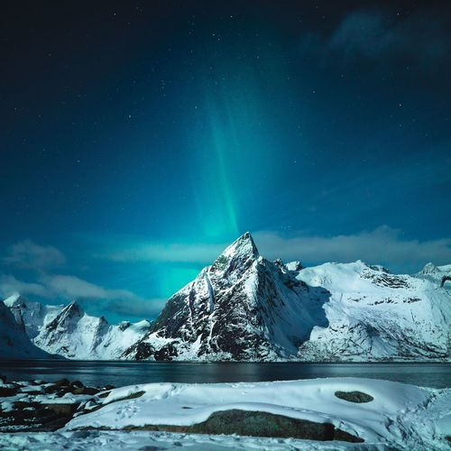 Reine under the Aurora Space Astronomy Sky Star - Space Snow Cold Temperature Night Beauty In Nature Scenics - Nature Winter Mountain Environment Nature Landscape Galaxy Space And Astronomy Tranquil Scene Science No People Tranquility