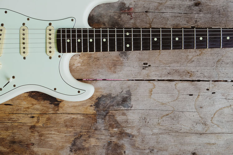 High angle view of guitar on wall