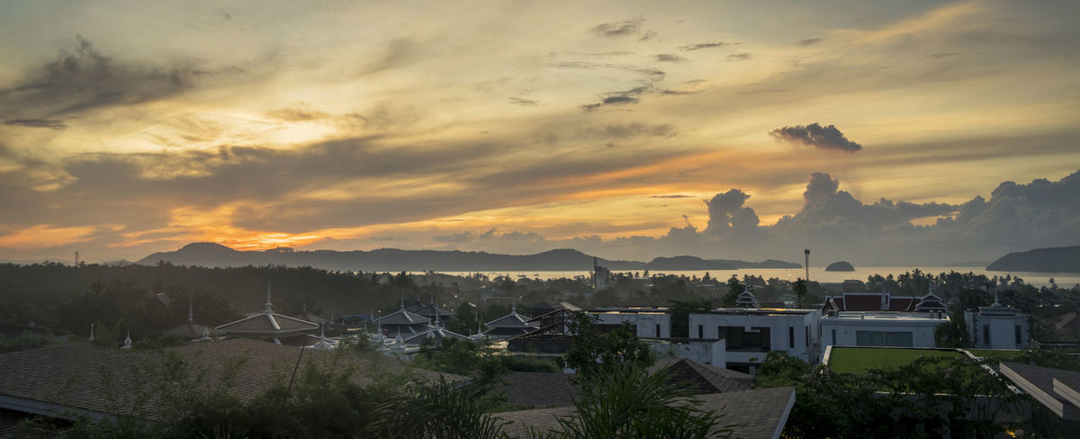 Beautiful Sunrise in Phuket, Thailand Architecture Beauty In Nature Building Exterior Built Structure City Cityscape Cloud - Sky Day House Mountain Nature No People Outdoors Residential Building Scenics Sky Sunset Topical Town Tree