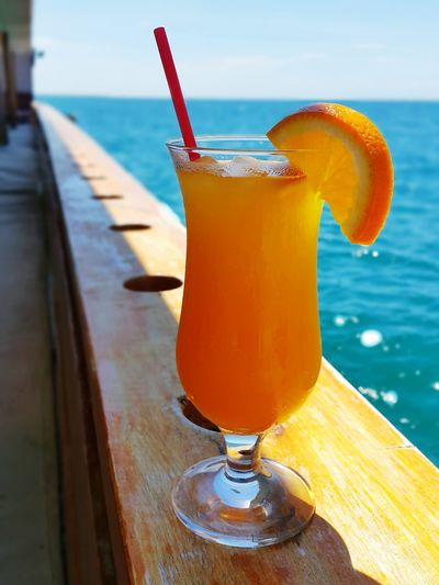 Orange Juice By Sea In Glass On Ship