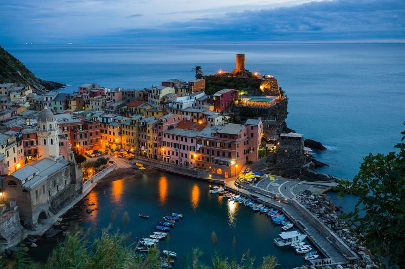 High angle view of buildings and sea at cinque terre during dusk