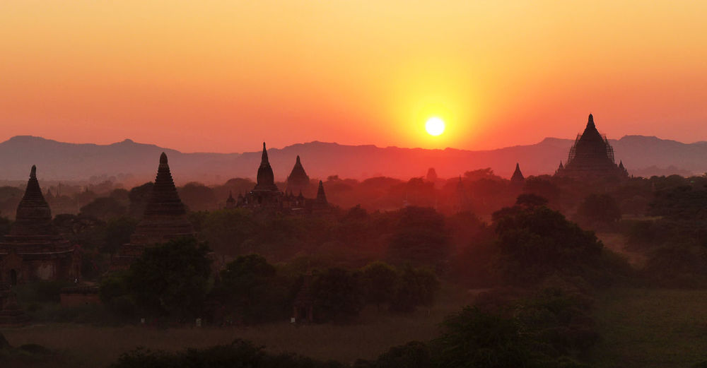 Bagan, Myanmar Ancient Ancient Civilization Architecture Beauty In Nature Building Exterior Built Structure Day Fog History Landscape Nature No People Outdoors Pagoda Place Of Worship Religion Scenics Silhouette Sky Spirituality Sunset Tourism Travel Destinations Tree