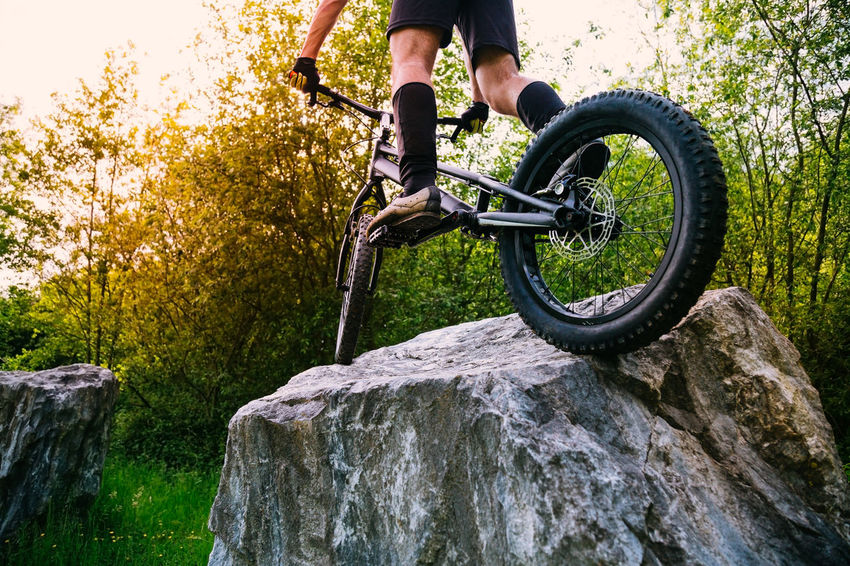 Cyclist Man RISK Balance Bicycle Bike Biker Cycling Extreme Sports Forest Jumping Nature One Person Outdoors Radical Sport Rocks Trial Bike Trick  Young Men