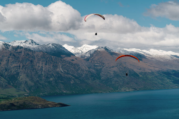 Adventure Beauty In Nature Cloud - Sky Cold Temperature Day Extreme Sports Flying Landscape Mountain Mountain Peak Mountain Range Nature No People Outdoors Parachute Paragliding Scenics Sea Sky Snow Sport