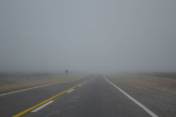 Empty Road Against Sky During Foggy Weather