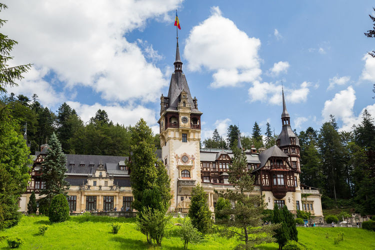 Romanian Castle Summertime View Peles Castle Castle Castles Romania Sinaia Building Exterior Built Structure Building Low Angle View The Past History Travel Destinations Cloud - Sky Architecture Sky Tree