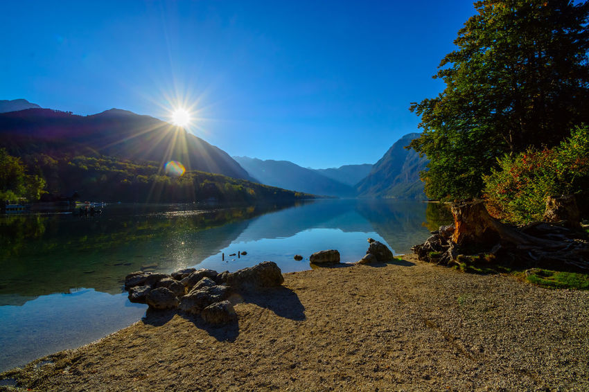 Nature Sky Day Bohinjsko Jezero Water Lake Sunlight Scenics - Nature Tranquility Beauty In Nature Lens Flare Sun Tranquil Scene Mountain Sunbeam Reflection Non-urban Scene Plant No People Tree Outdoors Bright