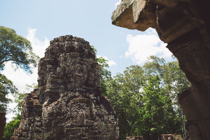Siem Reap Cambodia Angkor Belief Religion Spirituality Architecture Place Of Worship Built Structure Low Angle View Ancient History The Past Sky Day Human Representation Old Travel Destinations Travel Representation No People Ancient Civilization Outdoors Ruined