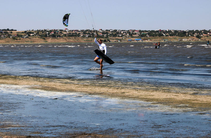 Beauty In Nature Coastline Day Enjoyment Firth Full Length Fun Jumping Kitesurfing Leisure Activity Lifestyles Lines Mid-air Motion Nature Outdoors Scenics Shore Tourist Tranquil Scene Tranquility Vacations Water Wave Sport