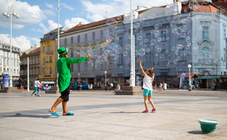 Full Length City Young Women Men Mid Adult Sky Acrobat Bubble Wand Bubble Blowing Stunt