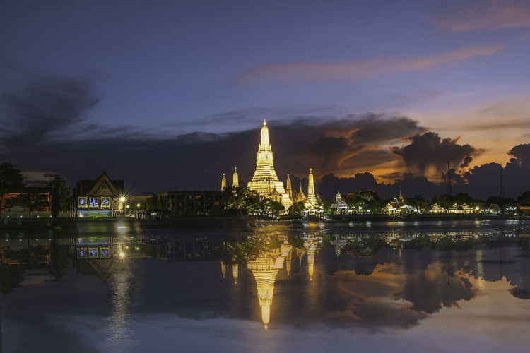 Wat Arun or Wat Arun is a temple on the west bank of the Chao Phraya River, Bangkok, Thailand. Architecture Belief Building Building Exterior Built Structure Cloud - Sky History Lake Nature No People Outdoors Place Of Worship Reflection Religion Sky Spirituality Travel Destinations Water Waterfront