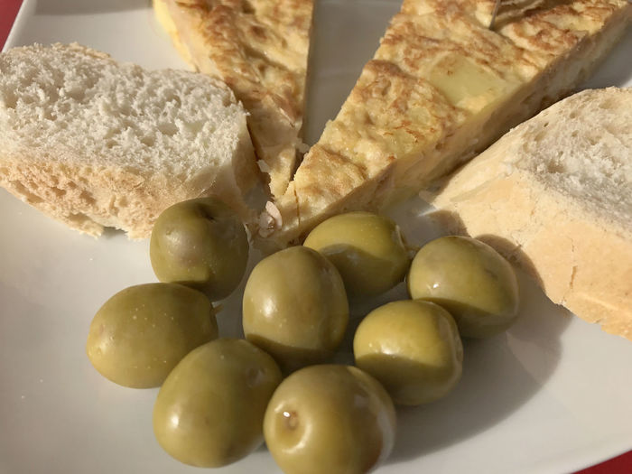 Tapas of olives bread and Spanish tortilla Bread Close-up Day Food Food And Drink Freshness Healthy Eating No People Olive Olive Plate Ready-to-eat Spanish Food Still Life Tapas Tortilla Española White Bread