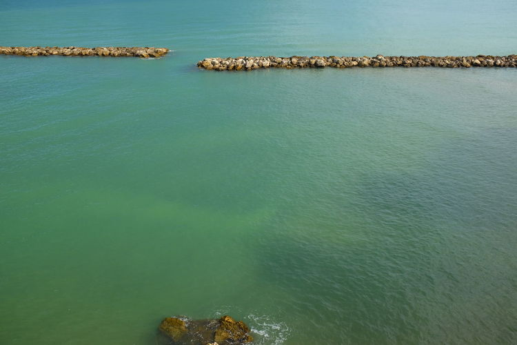 High angle view of calm blue sea