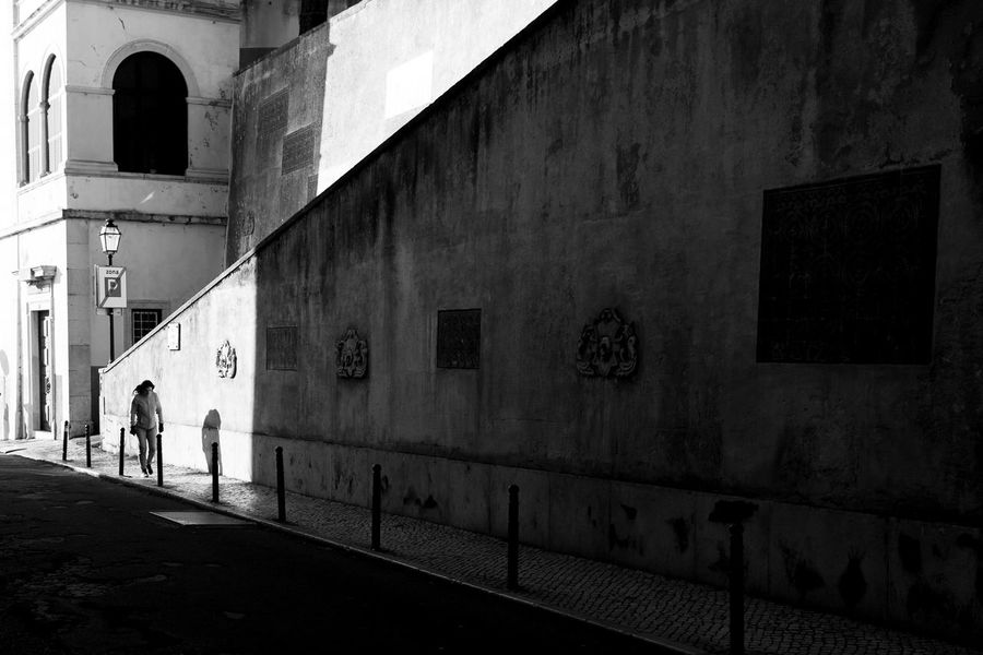 Streetphotography Streetphoto_bw Lisbon Street Photography Malephotographerofthemonth Street Photo Chasing Light City Men Walking Architecture Building Exterior Built Structure Focus On Shadow Long Shadow - Shadow Unrecognizable People The Street Photographer - 2018 EyeEm Awards
