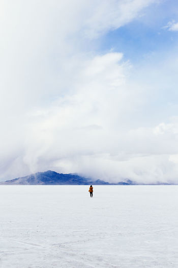 Beauty In Nature Cloud Cloud - Sky Cloudy Dramatic Sky Escapism Getting Away From It All Landscape One Person Outdoors Recreational Pursuit Salt Flats Salt Lake Scenics Sky Tranquil Scene Tranquility White Color The Great Outdoors - 2016 EyeEm Awards