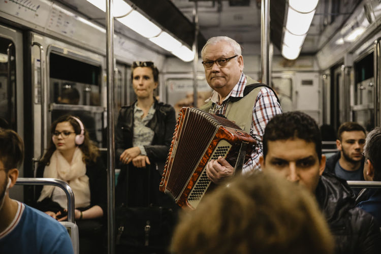 // this was my first time ever in Paris. So many Colours and so many different Cultures are living here. // The Traveler - 2018 EyeEm Awards Adult Artist Arts Culture And Entertainment Group Of People Indoors  Mature Men Medium Group Of People Men Music Musical Instrument Musician People Playing Public Transportation Rail Transportation Real People Senior Adult Sitting Train Women