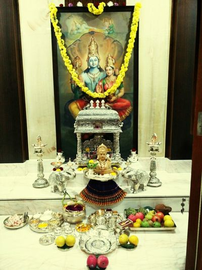 Gow Religionri pooja our friend home Spirituality Place Of Worship Art And Craft Human Representation Art Religious Offering Hindu God Religion Statue God Incense Candle Ornate Gold Candlestick Holder Façade Decoration Religious Celebration Creativity First Eyeem Photo