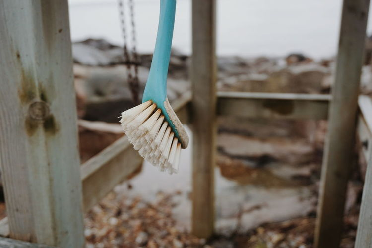 Cleaning Cleaning Equipment Fishing Village Barrier Boundary Brush Cleaning Brush Close-up Connection Day Fence Fishing Focus On Foreground Hanging Metal Nature No People Outdoors Pole Rope Selective Focus Wood - Material Wooden Post