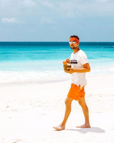 Men Man Coconut Coconuts White Beach Praslin Seychelles Seychelles Islands Water Sea Full Length Beach Sand Men Standing Looking At Camera Protection Portrait Snorkeling Coconut Palm Tree Coastline Surf Wave Lifeguard  Coastal Feature Ocean Tide Shore Rocky Coastline Mask - Disguise