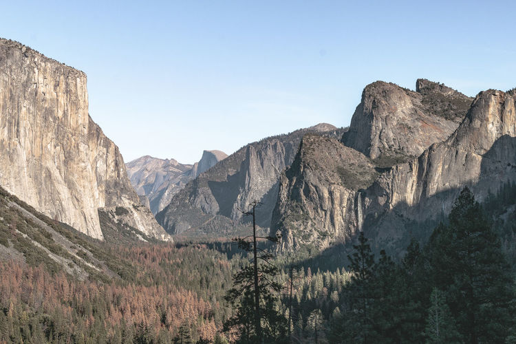 Yosemite National Park by Trevor J. Brown Scenic mountain region comprising the Sierra Nevada Range & Yosemite Valley of the Merced river; famous for giant sequoias, huge rock domes & peaks. Canon EOS REBEL T5 30mm 30mm/ƒ/10/1/125s/ISO 100 Beauty In Nature Day Fossil Geology Landscape Mountain Mountain Range Nature No People Outdoors Rock - Object Scenics Travel Destinations Yosemite Yosemite National Park