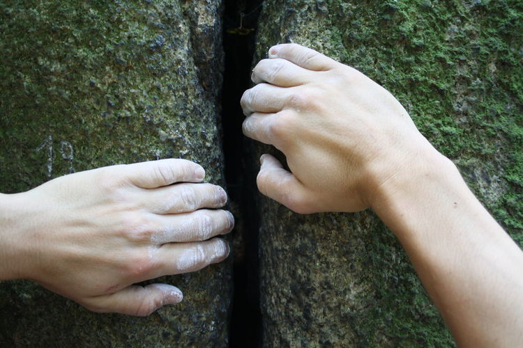 Cropped hands holding rocks