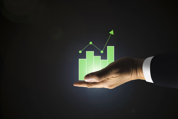 Human Body Part Human Hand Hand One Person Sign Copy Space Business Studio Shot Arrow Symbol Green Color Indoors  Nature Communication Close-up Illuminated Graph Holding Body Part Men Finger Line Graph