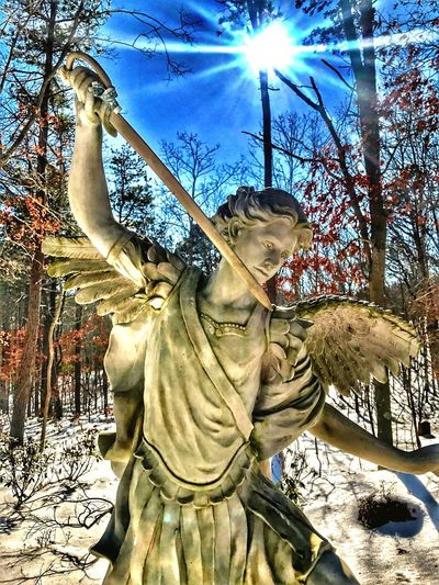 St.MichaelTheArchangel-DefendUsInBattle Statue Tree Sculpture No People Outdoors Sunlight Sky Day Low Angle View Bare Tree Sun Saint Michael The Archangel Shrine Shrine Of Our Lady Of The Island Long Island, Ny Saint Michael