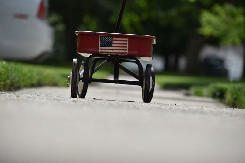 All American cart American Culture Childs Cart Selective Focus Mode Of Transportation No People Day Communication Transportation Sign Focus On Foreground