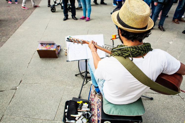 Busker Back Busker Folk Guitarist Hippielife Leisure Activity Lifestyles Music Street Street Artist
