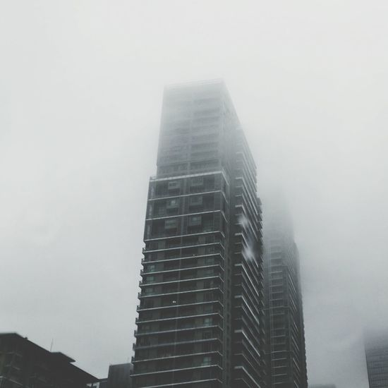 Not a very good idea to take quick snaps while driving. Don't use your phone while driving. But this one I really couldn't let pass and was taken quickly right after an 80-second traffic light stop. Fog Skyscraper City Urban Skyline Low Angle View Architecture Outdoors Sky Day Smartphonephotography HuaweiP9plus Quicksnap Bonifacio Global City BGC Taguig