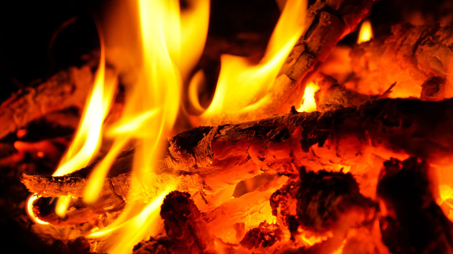 Burning wood in a campfire. Campfire Flame Flames Hot Ash Bonfire Burning Close-up Coal Fire Fire - Natural Phenomenon Flame Glowing Heat - Temperature Motion Nature Night No People Orange Color Outdoors Wood - Material