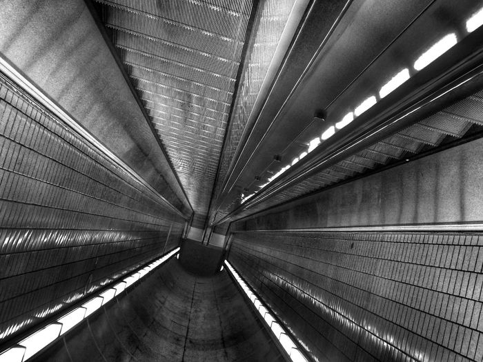 Upside down image of escalator and ceiling