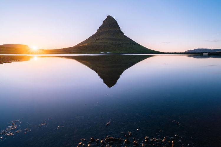 Kirkjufell Reflection Iceland Kirkjufell View Beauty In Nature Idyllic Lake Land Landmark Mountain Nature No People Non-urban Scene Outdoors Reflection Rocks Scenics Sky Sun Sunlight Sunset Tranquil Scene Tranquility Water Waterfront