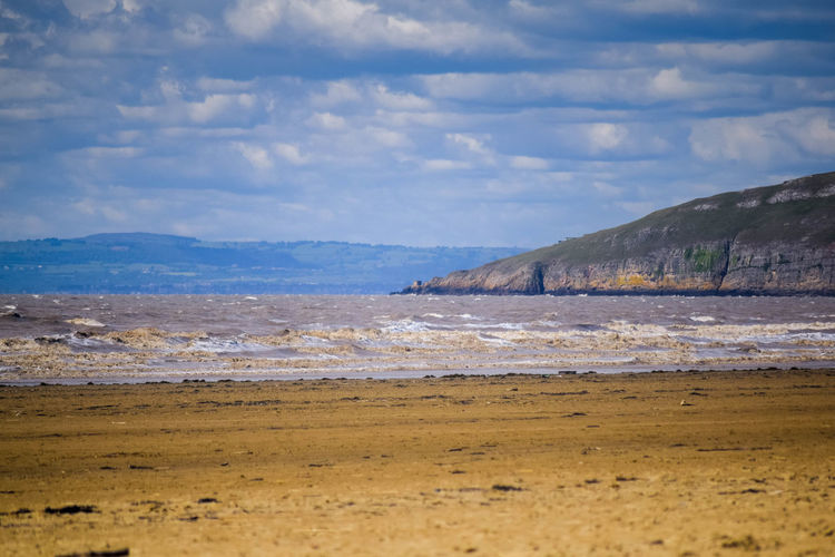 Sky Land Sea Beach Nature Water Beauty In Nature Scenics - Nature Sand Outdoors Beach Photography Horizon Over Water Landscape Beachscape Leading Lines Blue Sky Cloud - Sky Tranquility Tranquil Scene No People Day Mountain Non-urban Scene Wave Motion Brean Down