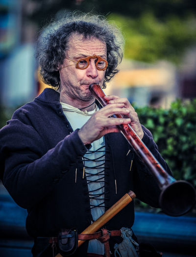 Mid Adult Man Playing Flute