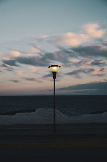 I found this lamp somewhat mystical. Afternoon Lights On Beauty In Nature Cloud - Sky Cloud Formations Clouds And Sky Dusk Horizon Horizon Over Water Idyllic Land Light Lighting Equipment Nature No People Outdoors Scenics - Nature Sea Sky Street Street Light Sunset Tranquil Scene Tranquility Water