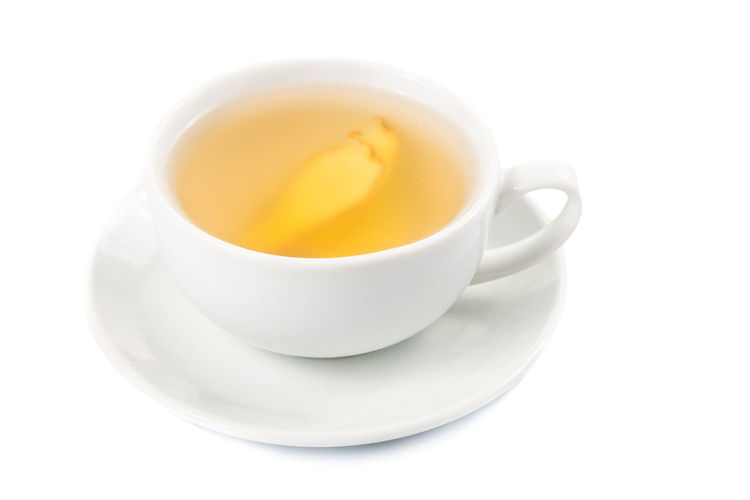 Refreshing and healthy ginger drinks Ginger Tea Tea Close-up Cup Cut Out Drink Food Food And Drink Freshness Ginger Hot Drink Indoors  No People Non-alcoholic Beverage Refreshing Refreshment Saucer Still Life Studio Shot Tea Tea - Hot Drink Tea Cup White Background White Color