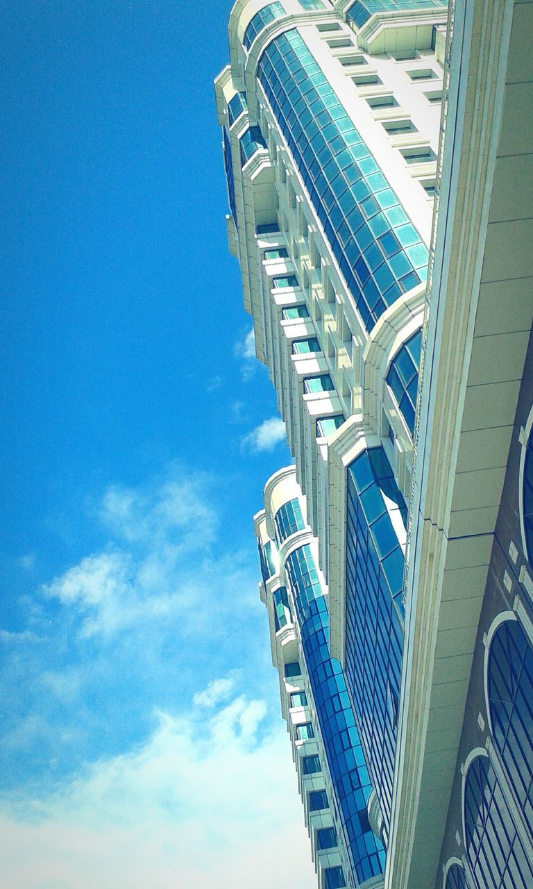 architecture, built structure, low angle view, modern, building exterior, day, sky, skyscraper, blue, city, outdoors, no people