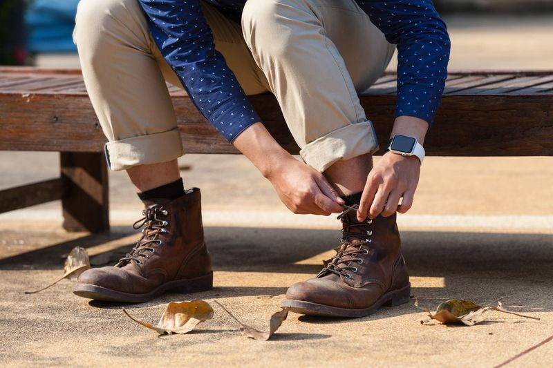 Low Section Of Man Tying Shoelaces