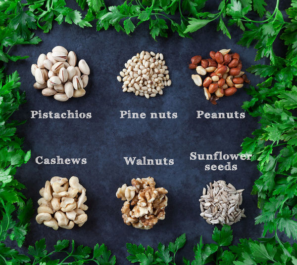 Pistachios, pine nuts, peanuts, cashews, walnuts, and sesame seeds with parsley on grunge background. Flat lay. Nuts Basil Blackboard  Cashew Choice Close-up Day Directly Above Food Food And Drink Food Staple Freshness Hazelnut Healthy Eating Healthy Lifestyle High Angle View No People Nut - Food Peanut Peanut - Food Pine Nut Pistachio Raisin Raw Potato Text Variation Vegetable Vegetarian Food Walnut