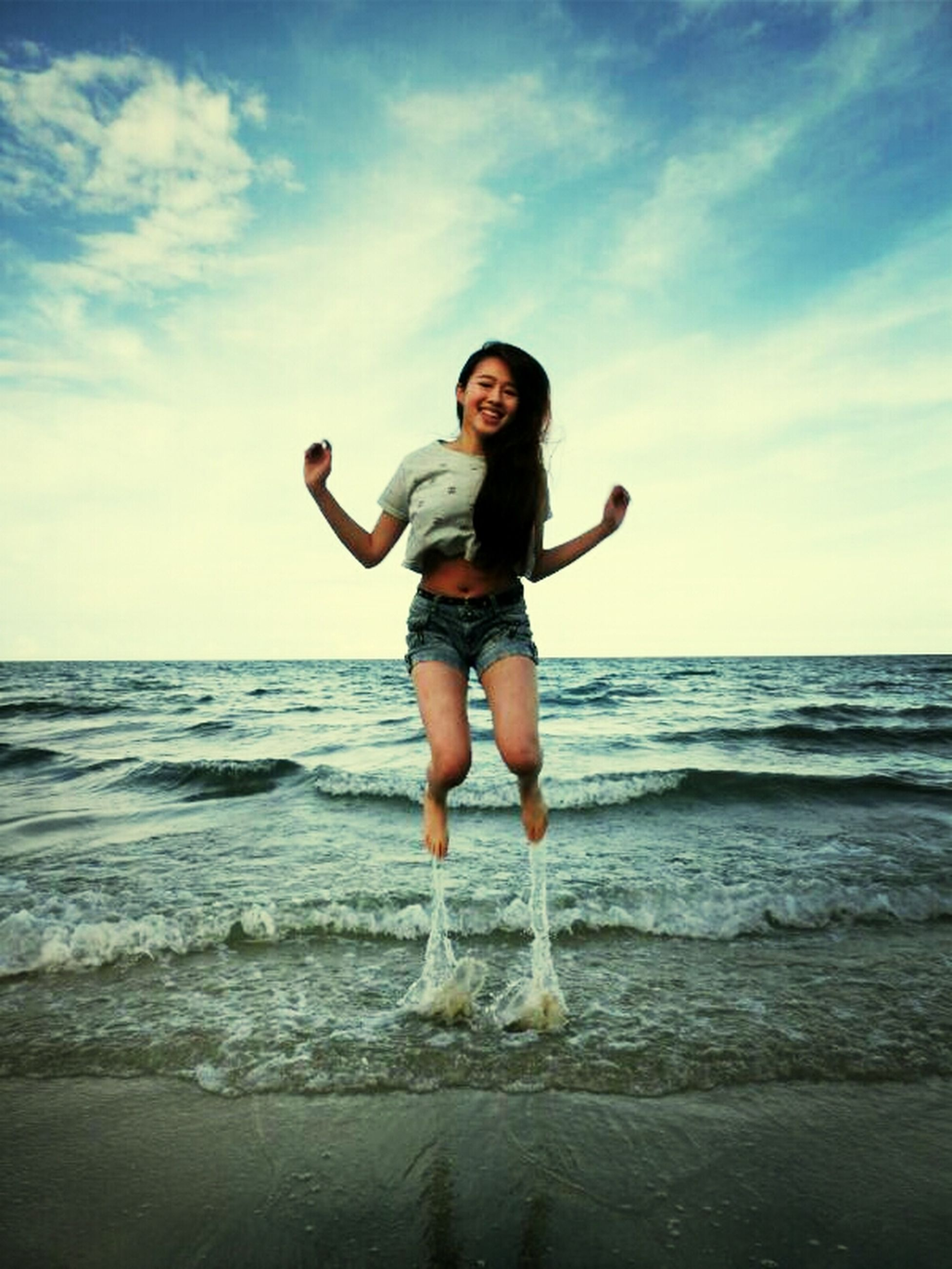 water, sea, person, lifestyles, beach, leisure activity, full length, horizon over water, young adult, sky, shore, vacations, casual clothing, enjoyment, young women, happiness, fun, portrait
