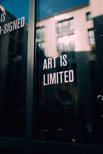 Art Ist Limited Reflection Quote Quotes About Art Communication Text Western Script Sign Glass - Material Architecture Window Transparent Information Capital Letter No People Information Sign Built Structure Building Exterior Mode Of Transportation Transportation City Outdoors Message