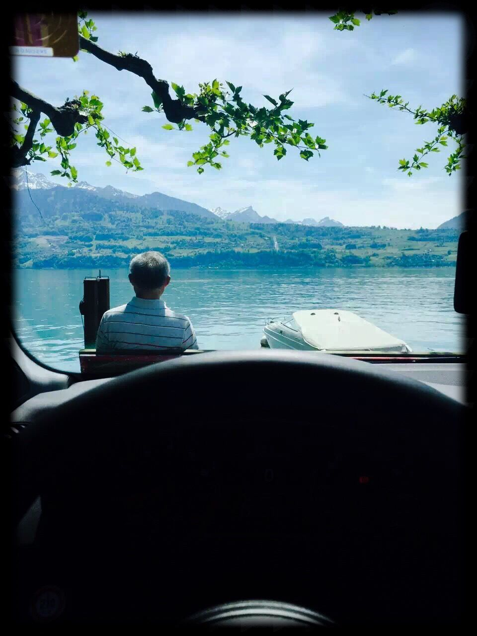 transportation, mode of transport, steering wheel, car, travel, water, day, journey, nature, sea, car interior, sky, scenics, beauty in nature, no people, nautical vessel, tree, close-up, outdoors