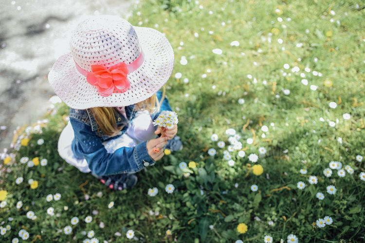 Springtime Outdoors Sun Hat Leisure Activity Grass Full Length Nature Casual Clothing Innocence Plant Girls Day Females Clothing Offspring One Person Childhood Child Hat Ring Lawn Picking Flowers  Daisy Flower
